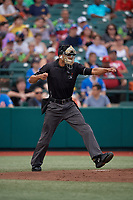 Umpire Jon-Tyler Shaw calls strike three during a NY-Penn League game between the Tri-City ValleyCats and Brooklyn Cyclones on August 17, 2019 at MCU Park in Brooklyn, New York.  Brooklyn defeated Tri-City 2-1.  (Mike Janes/Four Seam Images)