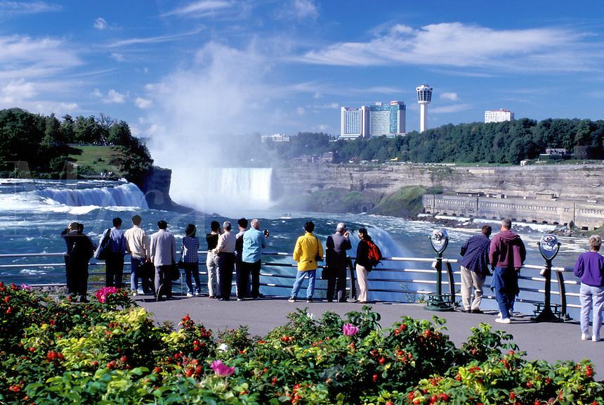 Niagara Falls, NY, waterfalls, New York, People at Prospect Park overlook looking at Niagara Falls. American Falls and Canadian Falls (Horseshoe Falls)