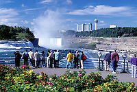 Niagara Falls, NY, waterfalls, New York, People at Prospect Park overlook looking at Niagara Falls. American Falls and Canadian Falls (Horseshoe Falls)