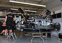 September 19, 2013: <br /> <br /> Engineers work on Kevin Weeda (USA) \ Vitantonio Liuzzi (ITA) \ James Rossiter (GBR) of Lotus  #31 LMP2 Lotus T128 in the garage during International Sports Car Weekend test and setup session at Circuit of the Americas in Austin, TX.