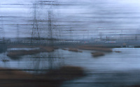 Available For Editorial and Commercial Licensing Exclusively from Getty Images.  Please go to www.gettyimages.com and search for image # 200418072-001<br /> <br /> Available Directly from Jeff as a Fine Art Print<br /> <br /> Blurred Motion View of Industrial Area in the New Jersey Meadowlands, Viewed from Window of a Moving Passenger Train, New Jersey, USA