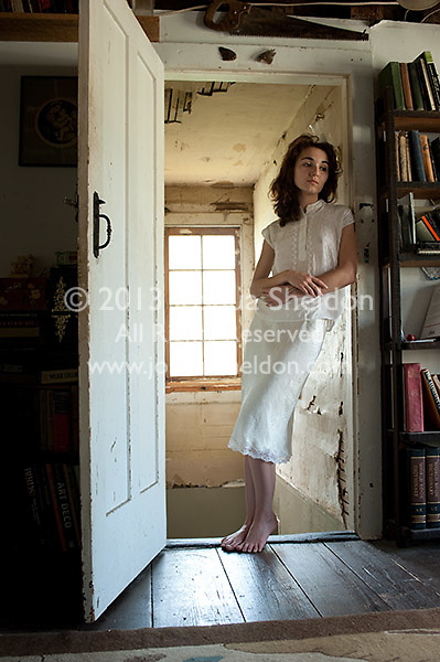 Young woman standing in doorway