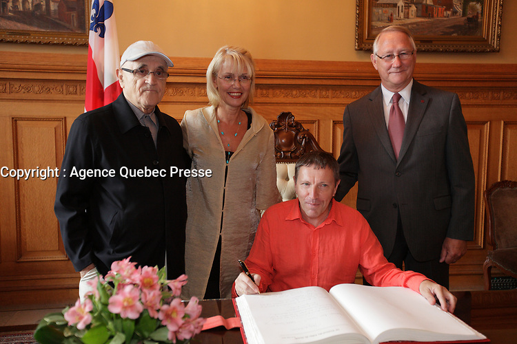 August 27 2012 - Montreal (Qc) CANADA - <br /> The jury of the 2012 World Film Festival at  Montreal City hall.<br /> Serge Losique,Helen Foutopoulos<br /> and Gerald Tremblay, Mayor of Montreal stand behind  Andrei Plakhov<br /> <br /> The World Films Festival 35th edition run til September 2012.<br /> <br /> <br />  File Photo Agence Quebec Presse - Pierre Roussel