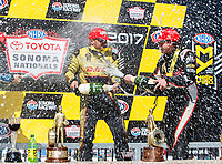 Jul 30, 2017; Sonoma, CA, USA; NHRA funny car driver J.R. Todd (left) sprays champagne with top fuel driver Steve Torrence as they celebrate after winning the Sonoma Nationals at Sonoma Raceway. Mandatory Credit: Mark J. Rebilas-USA TODAY Sports
