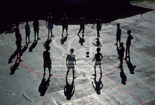 Belem, Brazil. Young boys playing with a football in a circle.