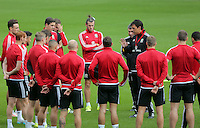CARDIFF, WALES - SEPTEMBER 05: Gareth Bale joined by team mates are briefed by manager Chris Coleman (R) prior to the Wales training session, ahead of the UEFA Euro 2016 qualifier against Israel, at the Cardiff City Stadium on September 5, 2015 in Cardiff, Wales.