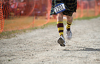 "Runners compete in the ""Kilted Mile"" during the 2015 Alaska Scottish Highland Games at the Palmer fairgrounds."