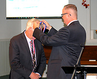 Marc Hayot/Herald Leader Former Pvt. Jerry Hart (left), receives the medal from the United States Army Medical Research Institute for Infectious Diseases Whitecoat Program 1954-1973 from Chaplain William Corker.