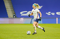 LE HAVRE, FRANCE - APRIL 13: Julie Ertz #8 of the United States moves with the ball during a game between France and USWNT at Stade Oceane on April 13, 2021 in Le Havre, France.