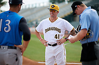 Bradenton Marauders coach Adam Godwin (41) during the lineup exchange with Pat Osborn (13) and umpire Louie Krupa (right) before a game against the Tampa Tarpons on August 12, 2018 at LECOM Park in Bradenton, Florida.  The game was suspended in the bottom of the first inning due to weather.  (Mike Janes/Four Seam Images)