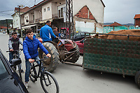 Serbia. Veliki Trnovac (in Albanian: Tërnoc i Madh) is a town in the municipality of Bujanovac, located in the Pčinja District of southern Serbia. Albanian men sitting on a tractor pull a trailer with a cow. Albanian boys on bicycles on the asphalt road. Street life. Bujanovac is located in the geographical area known as Preševo Valley. The Pestalozzi Children's Foundation (Stiftung Kinderdorf Pestalozzi) is advocating access to high quality education for underprivileged children. It supports in Bujanovac a project called» Our towns, our schools». 16.4.2018 © 2018 Didier Ruef for the Pestalozzi Children's Foundation