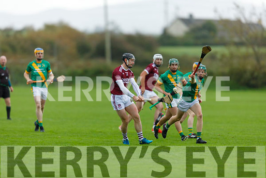 Causeway' s Bryan Murphy about to get his effort away as  Kilmoyley's Daire Nolan attempts to block him, in the North Kerry Senior Hurling Championship final