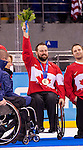 Sochi, RUSSIA - Mar 15 2014 - Billy Bridges receives his Bronze medal in Sledge Hockey at the 2014 Paralympic Winter Games in Sochi, Russia.  (Photo: Matthew Murnaghan/Canadian Paralympic Committee)
