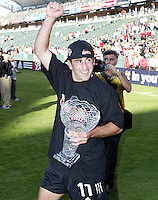 14 November 2004: Alecko Eskandarian with his MVP trophy after DC United defeated Kansas City Wizards, 3-2 at Home Depot Center in Carson, California...Mandatory Credit: Michael Pimentel / www.internationalsportsimages.com..