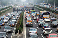 Traffic jam in Beijing, China. Over a thousand new cars are added to the streets of Beijing daily adding to severe pollution problems. .