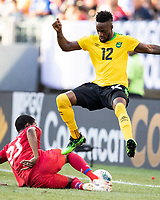 PHILADELPHIA, PA - JUNE 30: Michael Murillo #23 slides to the ball against Junior Flemmings #12 during a game between Panama and Jamaica at Lincoln Financial FIeld on June 30, 2019 in Philadelphia, Pennsylvania.
