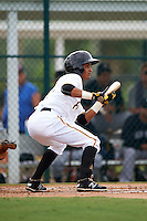 GCL Pirates shortstop Adrian Valerio (57) squares to bunt during the first game of a doubleheader against the GCL Yankees 2 on July 31, 2015 at the Pirate City in Bradenton, Florida.  GCL Pirates defeated the GCL Yankees 2 2-1.  (Mike Janes/Four Seam Images)