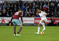 Pictured: Neil Taylor of Swansea (R) against Carl Jenkinson of West Ham (L) Saturday 10 January 2015<br /> Re: Barclays Premier League, Swansea City FC v West Ham United at the Liberty Stadium, south Wales, UK