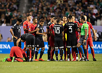 CHICAGO, IL - JULY 7: Players on both team discuss a foul on Jozy Altidore #17 during a game between Mexico and USMNT at Soldiers Field on July 7, 2019 in Chicago, Illinois.