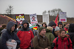 "© Joel Goodman - 07973 332324 . 26/01/2014 . Salford , UK . A woman holds a placard with "" Beware Fracula "" around a photograph of Prime Minister David Cameron . Approximately 500 protesters march to an iGas fracking exploration site at Barton Moss , Salford , today (Sunday 26th January 2014) . They walk along the A57 road , blocking traffic as they do . A long term protest camp has been established on an access road leading to the site and today (26th January) protesters from other areas of the country travelled to the site to join with other protesters against fracking . Photo credit : Joel Goodman"