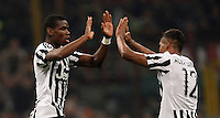 Calcio, Serie A: Milan vs Juventus. Milano, stadio San Siro, 9 aprile 2016. <br /> Juventus' Paul Pogba, left, celebrates with teammate Alex Sandro after scoring the winning goal during the Italian Serie A football match between AC Milan and Juventus at Milan's San Siro stadium, 9 April 2016. Juventus won 2-1.<br /> UPDATE IMAGES PRESS/Isabella Bonotto