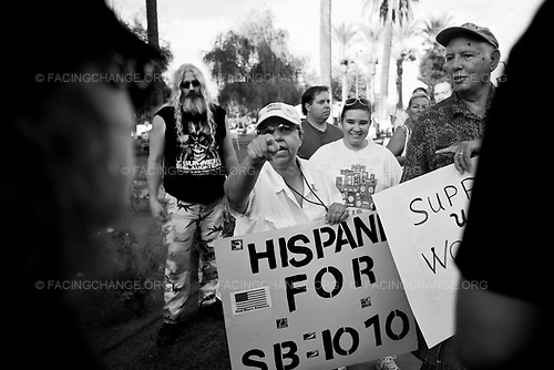 Phoenix, Arizona, USA<br /> June 2010 <br /> <br /> Pro SB 1070 supporters argue with a anti SB 1070 members at a rally on the Arizona State Capitol grounds during a public rally held in favor of Arizona's controversial Senate Bill, 1070 aimed at illegal immigration, Phoenix, Arizona, USA, on 31 July 2010. The state's controversial law went into effect at 12 01 am on 29 July but with a limited effect as Judge Susan Bolton put a injunction on the most controversial parts that many people say was unconstitutional and based on racial profiling.