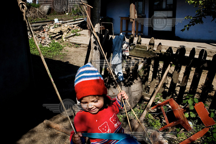 A young girl plays on a swing outside a house in rural Gagauzia, an autonomous region of Moldova.