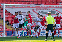 24th April 2021, Oakwell Stadium, Barnsley, Yorkshire, England; English Football League Championship Football, Barnsley FC versus Rotherham United; Callum Brittain of Barnsley hooks the ball clear from a Rotherham corner