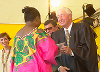 July 1 2002, Montreal, Quebec, Canada<br /> <br /> An African Woman  receive her Canadian citizenship,<br /> from Jean Beliveau, Ceremonies President,<br />  in an official ceremony, July 1st 2001, in the Old-Port of Montreal. No Model Release <br /> <br /> Mandatory Credit: Photo by Pierre Roussel- Images Distribution. (©) Copyright 2002 by Pierre Roussel