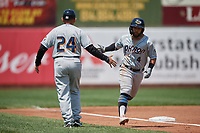Akron RubberDucks manager Rouglas Odor (24) congratulates Ka'ai Tom (4) as he rounds the bases after hitting a home run during an Eastern League game against the Erie SeaWolves on June 2, 2019 at UPMC Park in Erie, Pennsylvania.  Akron defeated Erie 7-2 in the first game of a doubleheader.  (Mike Janes/Four Seam Images)
