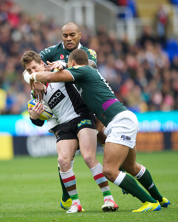 Tom Williams of Harlequins is tackled by Sailosi Tagicakibau and Guy Armitage of London Irish during the Aviva Premiership match between London Irish and Harlequins at the Madejski Stadium on Sunday 28th October 2012 (Photo by Rob Munro)