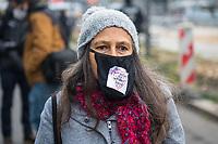 """Ca. 70 Menschen protestierten am Mittwoch den 2. Dezember 2020 in Berlin vor Medienhaeusern gegen die ihrer Meinung nach, unausgewogene Berichterstattung ueber die Proteste von Coronaleugnern und forderten, dass sie und als Coronaleugner bekannte Aerzte als Experten in Talkshows eingeladen werden.<br /> Im Bild: Eine Demonstrantin traegt einen Damnslip als Mase mit einen Stueck Stoff auf dem in einem Herz """"wir wollen die Wahrheit hoeren!"""" steht.<br /> 2.12.2020, Berlin<br /> Copyright: Christian-Ditsch.de"""