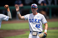 Duke Blue Devils third baseman Erikson Nichols (42) heads to the dugout against the Liberty Flames in NCAA Regional play on Robert M. Lindsay Field at Lindsey Nelson Stadium on June 4, 2021, in Knoxville, Tennessee. (Danny Parker/Four Seam Images)