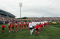 The U.S. and Canadian National Teams walk onto the field. The U.S. Women's National Team defeated Canada 1-0 in a friendly match at Marina Auto Stadium in Rochester, NY on July 19, 2009. Abby Wambach of the USWNT scored her 100th career goal in the second half..