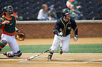 Nate Mondou (10) of the Wake Forest Demon Deacons starts down the first base line during the game against the Miami Hurricanes at Wake Forest Baseball Park on March 22, 2015 in Winston-Salem, North Carolina.  The Demon Deacons defeated the Hurricanes 10-4.  (Brian Westerholt/Four Seam Images)