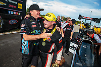 Oct 7, 2018; Ennis, TX, USA; NHRA top fuel driver Steve Torrence celebrates with Scott Palmer after winning the Fall Nationals at the Texas Motorplex. Mandatory Credit: Mark J. Rebilas-USA TODAY Sports