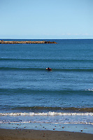 Surfers at Lyall Bay in Wellington, New Zealand on Saturday, 11 September 2021. Photo: Dave Lintott / lintottphoto.co.nz