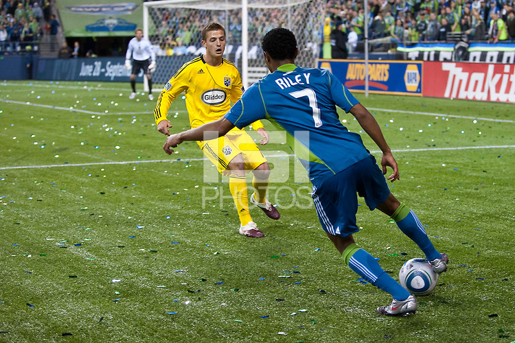 James Riley(7) of the Seattle Sounders works the ball against Robbie Rogers (left) of the Columbus Crew at the XBox 360 Pitch at Quest Field in Seattle, WA on May 1, 2010. the Sounders and Crew played to a 1-1 draw.