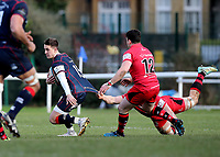 Tom Parton of London Scottish is tackled during the Greene King IPA Championship match between London Scottish Football Club and Jersey at Richmond Athletic Ground, Richmond, United Kingdom on 16 December 2017. Photo by Mark Kerton / PRiME Media Images.