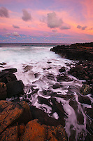 A spectacularly colored sunset on Kauai's south shore.  The retreating waves make interesting swirls as the water rushes back toward the sea.