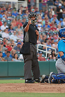 Umpire Luis Hernandez calls a strike during a Texas League game between the Amarillo Sod Poodles and Frisco RoughRiders on July 13, 2019 at Dr Pepper Ballpark in Frisco, Texas.  (Mike Augustin/Four Seam Images)