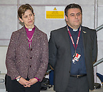 © Joel Goodman - 07973 332324 . 09/02/2015 . Manchester , UK . Wife and husband Libby Lane ( Bishop of Stockport) and George Lane ( pastor at Manchester Airport . Bishop Libby Lane carries out her first public engagement since being ordained as the first woman Bishop in the Church of England . Bishop Libby Lane meets victims of human trafficking at Manchester Airport's Terminal 2 Arrival Lounge and speaks in support of efforts to clamp down on human trafficking . Photo credit : Joel Goodman