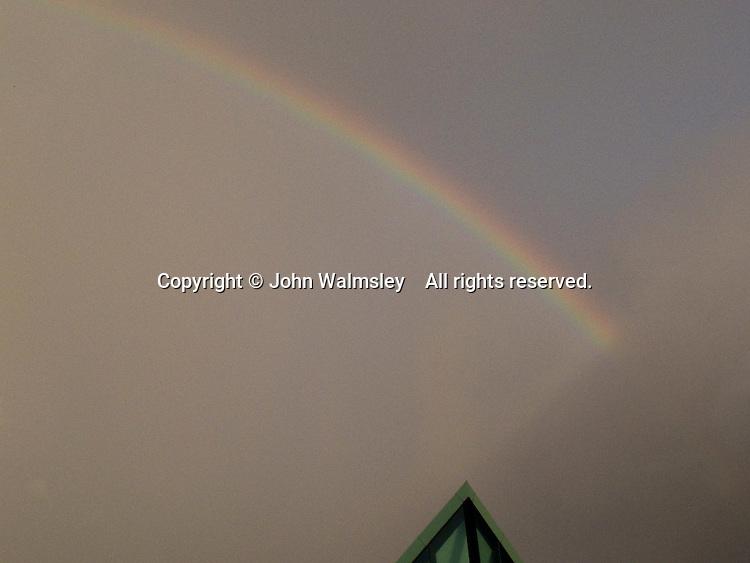 Rainbow over a modern building.