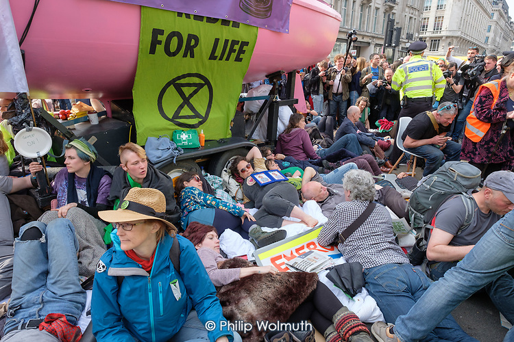 Extinction Rebellion climate change campaigners occupy Oxford Circus, London.
