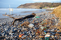 Tuesday  09 February 2016<br /> Pictured: Bottles and other rubbish washed up on Pendine Beach, Carmarthenshire<br /> Re:  Debris left on the beach in the aftermath of Storm Imogen