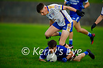 Annascaul's Joe Kennedy takes possession despite the attention from Shane Prenderville of Keel in the Junior Premier football championship