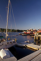 AJ4471, Maine, harbor, Atlantic Ocean, Sailboat and fireboats moored at the docks on the harbor in Belfast in the state of Maine.