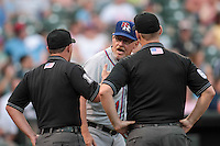 Round Rock Express manager Bobby Jones argues a call with umpires at home plate during the Pacific Coast League game against the Oklahoma City RedHawks at Chickashaw Bricktown Ballpark on June 14, 2013 in Oklahoma City ,Oklahoma.  (William Purnell/Four Seam Images)