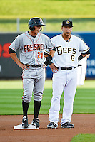 Gary Brown (21) of the Fresno Grizzlies and Taylor Lindsey (8) of the Salt Lake Bees during the game at Smith's Ballpark on April 9, 2014 in Salt Lake City, Utah.  (Stephen Smith/Four Seam Images)