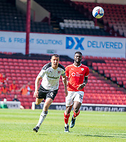 24th April 2021, Oakwell Stadium, Barnsley, Yorkshire, England; English Football League Championship Football, Barnsley FC versus Rotherham United; Richard Wood of Rotherham defending against Daryl Dike of Barnsley